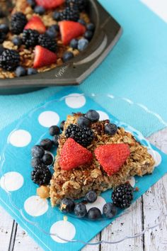 baked oatmeal dish covered with fresh berries