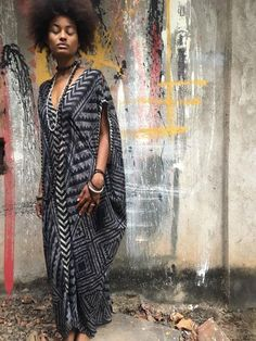 A wearable piece of art. This beautiful kaftan dress is lovingly detailed with hand block print, features a loose fit and comes with a wrap belt in a contrast print/color.