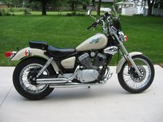 1990 Yamaha XV250 Route 66 (shown in rare pearl white) - The Route 66 was only made three years...'88, '89, '90. Then it came back in '99 as the Virago 250. Same bike. Parts readily available.