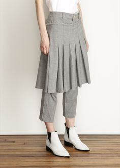 Pleated skirt with cropped trouser under layer in light grey wool. Button closure with zipper fly. Side buckle closure for wraparound skirt layer. Distressed and frayed top hem. Single button flap pocket at back. Tomboy Fashion, Modest Fashion, Fashion Outfits, Japan Fashion, Runway Fashion, Skirt Pants, Dress Skirt, Culottes, Comme Des Garcons