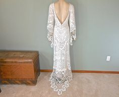 Gorgeous, hand made, off white lace bohemian wedding dress, made from vintage laces. Stunning boat neck with a sheer sweetheart shaped neckline,