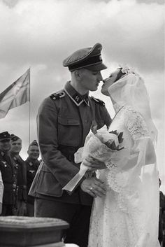 A soldier of 1. SS Panzer Division Leibstandarte Adolf Hitler and his bride.