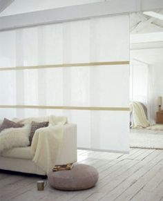 Use panel blinds to create a stylish room division