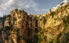 The 10 Most Underrated Cities in Spain Ronda  Andalucia Why it's worth the visit: Just look at that photo. Ronda is built on a cliff, which gives it a majestic view of the Tajo canyon. Settled in the sixth century, Ronda has Roman bridges and the idyllic laidback, Andalusian aesthetic many travelers seek. Sure, you'll get a good sense of Andalusia in, say Córdoba or Seville, but poking around the smaller cities and towns will give you a great sense of what the slow south is all about.