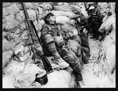 Soldier's comrades watching him as he sleeps, Thievpal, France, during World War I (National Library of Scotland).