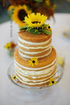 Jody and Garret's Camp Lakodia Naked Wedding Cake with fresh Sunflowers.