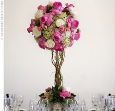 A tall romantic topiary centerpiece. Each tree was filled with green hydrangeas and lush pink roses.