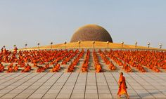 Buddhist monks pray while promoting world peace at the Wat Phra Dhammakaya temple in Thailand. Photograph: Sukree Sukplang/Reuters