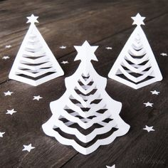 DIY Origami 3D Paper Christmas Trees that will look wonderful on your dining table.