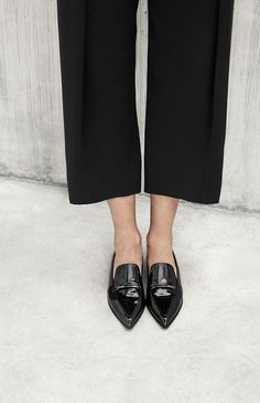Cropped black trousers and pointed loafers