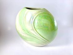 Excited to share this item from my shop: Ceramic Iridescent Green and Cream Round Vase Round Vase, Green Vase, Ceramic Vase, Vintage Home Decor, Iridescent, House Warming, Entryway, Etsy Shop, Shapes