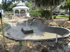 cement ponds | Concrete construction with stream from existing pond