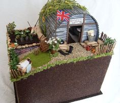 My Spring Fling 2009 entry is a WWII English Anderson (bomb) shelter in a suburban garden with a British Resistance Operational Base hidden underneath. School Projects, Projects For Kids, History Projects, School Ideas, World War 2 Display, Ww2 Bomb, Anderson Shelter, Bomb Shelter, Air Raid
