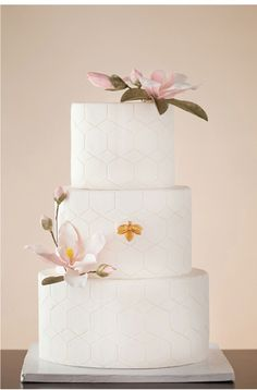 magnolia wedding cake. In love with the clean lines and simplicity.