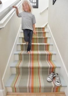 See how Kate from Centsational Girl transformed a dated, carpeted, worn-out staircase into a fun, functional, cheerful hallway by installing a stair runner. dash and albert striped runner painted stairs in porch paint in beautiful blue Painted Staircases, Painted Stairs, Spiral Staircases, House Stairs, Carpet Stairs, Basement Stairs, Wall Carpet, Hallway Carpet, Houses