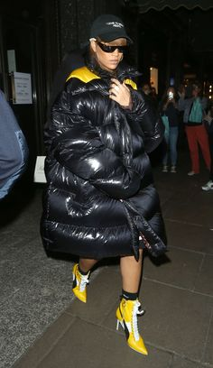 RiRi is making the summer puffer happen. Here she is wearing a PUFFER TENT while in London earlier this month (reminder: This month is AUGUST)