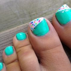 Easy pedicure: 1. Paint nails one color. 2. add a white stripe to the big toe. 3. Add different colors with a small brush!