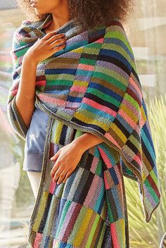 Free Knitting Pattern for Waterlilies Runner Stole - This rectangular shawl or throw is knit with sections of stockinette stripes of 17 colors in intarsia. Worsted.Designed by Kaffe Fassett for Rowan
