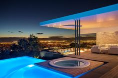 This modern South African house has stunning city views and a swimming pool and spa as well as a sunken outdoor lounge with firepit.