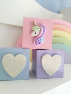 Set of three fairytale unicorn blocks, in soft pastel tones, a perfect addition to a little girls nursery, bedroom or playroom. These blocks have been hand sanded, hand painted and varnished by myself. Two of the blocks have glittered hearts, and the other a cute clay unicorn. Due to the embellishments on these cubes, they should be used for decorative purposes only, due to small parts which could pose a choking hazard. Therefore please keep out of reach of children at all times. Please…