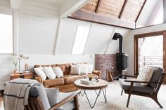 Before and After: An A-Frame Cabin Boasts Serious Scandinavian Vibes - Photo 8 of 14 - An old, European-style fireplace sets the scene for cozy, post-ski evenings. A Frame Cabin, A Frame House, Up House, Cottage House, Cabin Design, House Design, Bed Design, Fireplace Set, Hanging Fireplace