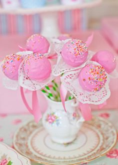 Like how they displayed in creamer w/saucer! sweet.....Shabby Chic Tea Party flower blossom cake pops