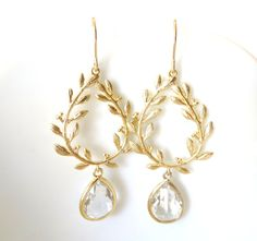 Hey, I found this really awesome Etsy listing at http://www.etsy.com/listing/153564281/gold-leaf-earrings-clear-crystal