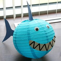 #DIY shark paper lantern. Hang up this adorable little creature from the ceiling. Your guests will feel like they are actually swimming with the sharks! Follow link for instructions for how to make