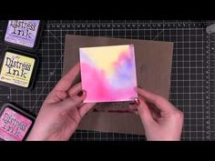 Bright watercolor background with distress inks