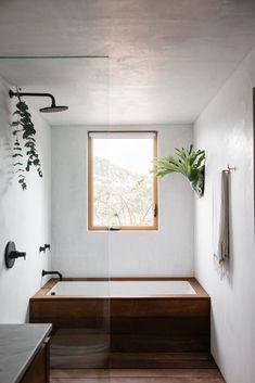 modern bathroom with wood bath tub. / sfgirlbybay