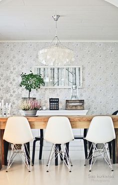 Love the mix of chairs and the gray floral wallpaper in this dining room.