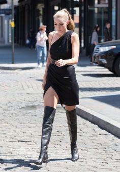 Gigi Hadid black thigh boots