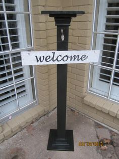 Entry sign holder with welcome sign