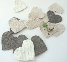 Seed Paper Hearts - cream, white, ivory, brown diy wedding favors, place cards, save the date cards, creative invitations. $15.95, via Etsy.