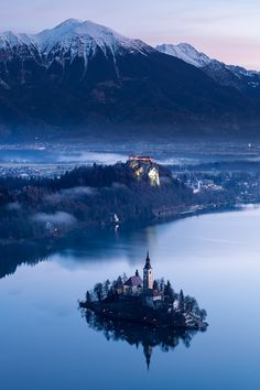 Blue Bled - Sunrise in Lake Bled, Slovenia Could you imagine living on that island?  Wow