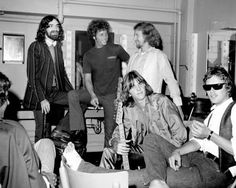 """The Flying Burrito Brothers pose backstage January 1, 1969 in Los Angeles; (L-R) Pianist/bassist Chris Ethridge, Chris Hillman, Gram Parson (seated), """"Sneaky"""" Pete Kleinow and drummer Michael Clarke."""