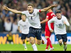 London, UK. 15th Oct, 2013. England Captain Steven GERRARD celebrates after scoring a goal during the World Cup Qualifier between England and Poland from Wembley Stadium. © Action Plus Sports/Alamy Live News
