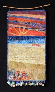 October Sunset. Small art quilt beach scene by Eileen Williams