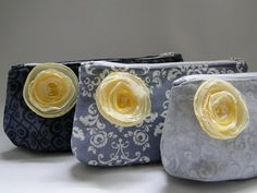 cosmetic bags in gray and yellow. Featured on @Emmalinebride