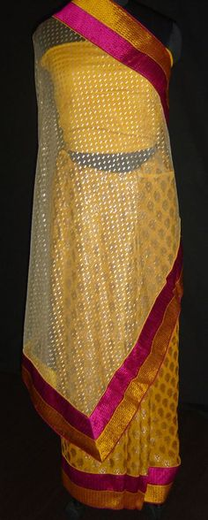 Georgette & net half-half saree. For orders and inquiries, please mail us at naari@aninditacreations.com.  Like our page www.facebook.com/naari.aninditacreations