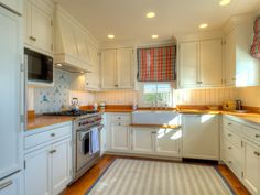 Nautical Kitchen : Small Floorplan - cabinetry, butcher block countertops, rug, roman shades. Everything except the backsplash
