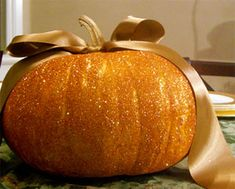 Glitter up your pumpkin for a glitzy pumpkin centerpiece.  Add a tasteful bow if you'ld like. #RobinBaron