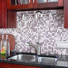 I love glass mosaic tiles but these purple ones add a great touch of color while brightening up the dark cabinets and counter tops.  I want my dream house to have color every where but not over the top