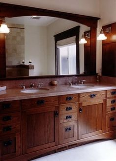 Fabulous craftsman style vanity and like the frame on the mirror