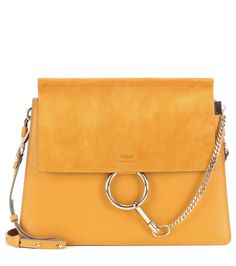 Chloé - Faye leather and suede shoulder bag - Chloé's 'Faye' bag is timeless and elegant. In mustard leather, it features a suede flap to the front and is accented with a pale gold-tone loop and chain detail. Go hands-free by wearing it cross-body, keeping all your essentials organised in the separate internal compartments. seen @ www.mytheresa.com