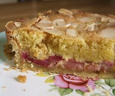 This delicious Rhubarb Bakewell Tart is a crisp pastry shell filled with roasted rhubarb and topped with almond frangipane sponge, so delicious!