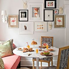 Tulip table with gold and monochrome chairs (and mini gallery wall)