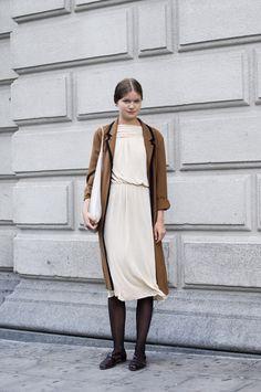 The Locals in Stockholm | white dress, brown trench style coat, dark tights  #minimalist #fashion  #modestfashion #modestdress #tzniutfashion #classicdress #formaldress #kosherfashion