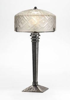DAUM AND LE FER FORGÉ TABLE LAMP shade engraved DAUM NANCY with the Croix de Lorraine base impressed LE FER FORGE H.F acid-etched glass and patinated hammered wrought iron 19 in. (48.3 cm) high 9 1/2 in. (24 cm) diameter of shade circa 1925
