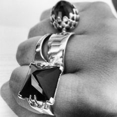 Model shot by Meadowlark. Onyx Cat paw ring, Protea Cocktail Ring
